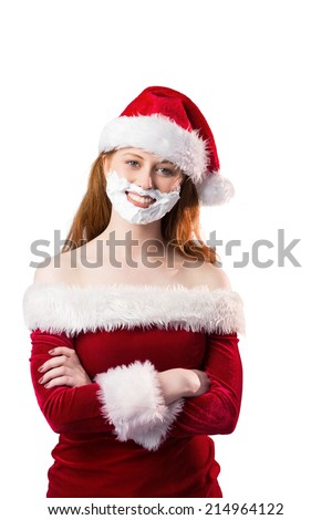 Festive redhead in foam beard on white background - stock photo