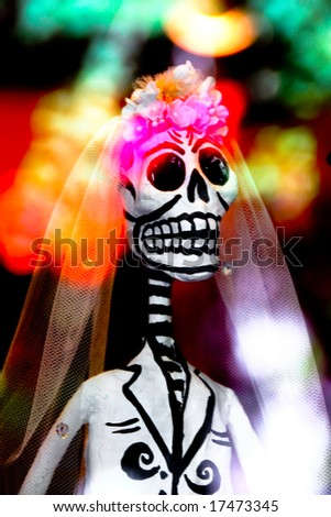 Festive skeleton bride and flowers on a colorful background perfect for Dia-de-los-Muertos - stock photo