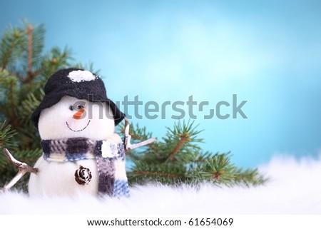 Festive snowman in seasonal setting - stock photo