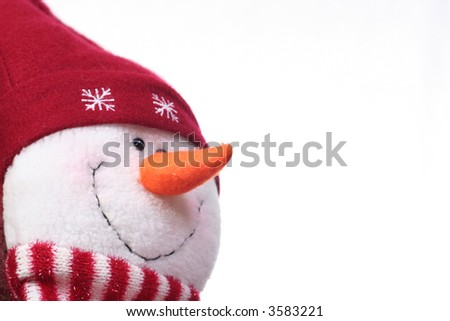 Festive snowman on white with plenty of copy space - stock photo