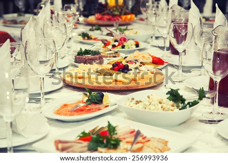 Festive table of salads and appetizers - stock photo