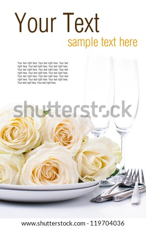 Festive table setting with beige roses, wine glasses, candles, napkins and cutlery, isolated, ready template - stock photo