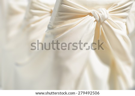 Festive wedding ceremony chair decoration of lightweight white fabric closeup, horizontal picture - stock photo