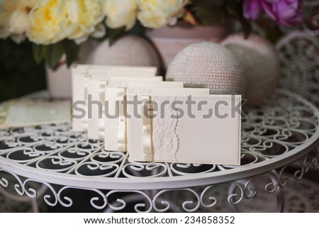festive wedding invitation in a gentle style on a background of flowers. - stock photo