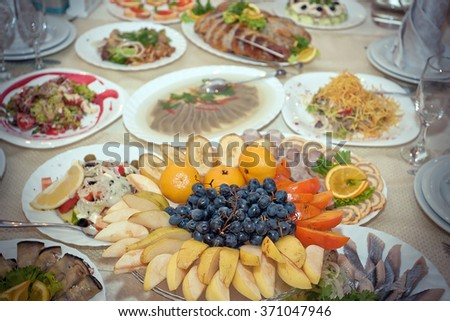 Festive well-laid table with food and drink - stock photo