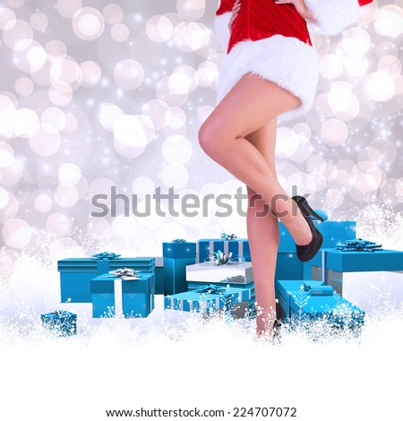 Festive womans legs in high heels against light glowing dots design pattern - stock photo