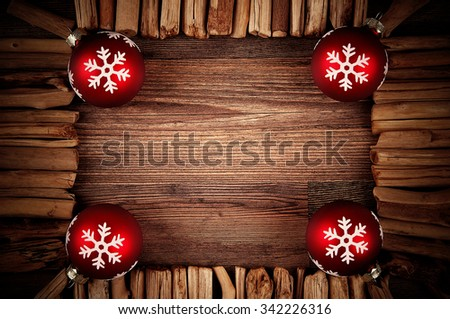 Festive wooden christmas background with red baubles - stock photo