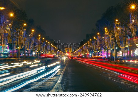 Festively decorated and illuminated Christmas Champs Elysees and Arc de triomphe Paris at night, France - stock photo