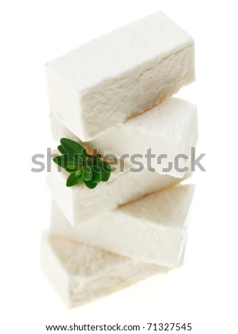 Feta cheese cubes with thyme twig, isolated on white - stock photo