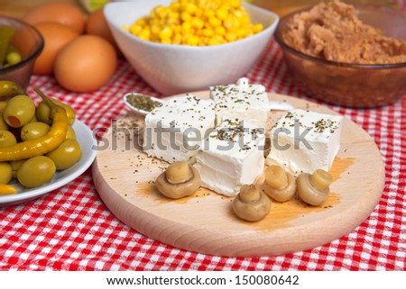 feta cheese with mushrooms on a kitchen table.
