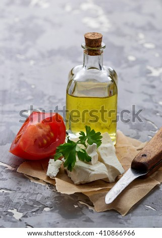 Feta cheese with tomato and oil. Selective focus - stock photo