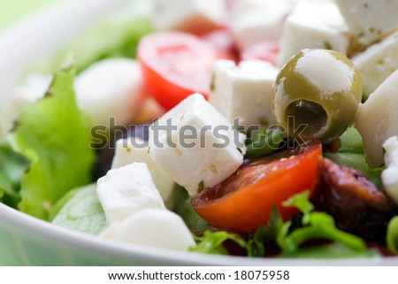 Feta salad with tomatoes and green olives - stock photo