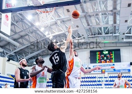Fethiye, Turkey - April 29, 2016 : Basketball players are playing during the Unilig University summer competitions on April 29, 2016 in Fethiye, Turkey.  - stock photo