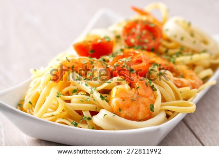 Fettuccine with shrimp and squid - stock photo