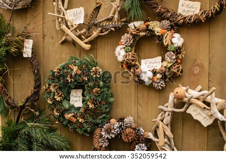Few christmas wreath on the wood wall - stock photo
