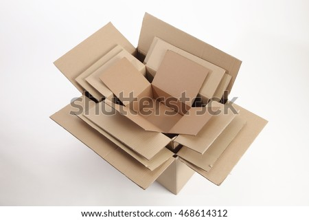 few different size cardboard boxes stack up for better protection