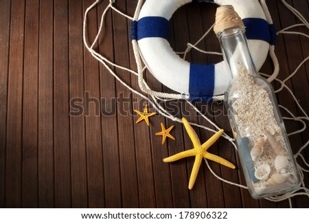 Few marine items on a wooden background. - stock photo