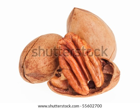 Few pecan nuts isolated on white, one cracked - stock photo