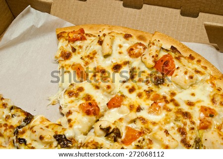 few pieces of hot pizza in box  - stock photo