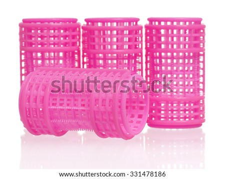 Few pink hair curlers, isolated on white background  - stock photo