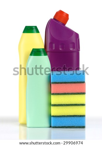 Few plastic bottles of cleaning liquids and sponges, isolated over white