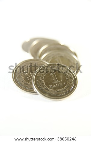 Few polish one zloty coins on white - stock photo