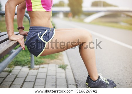 Few sit ups and different stretching exercises - stock photo