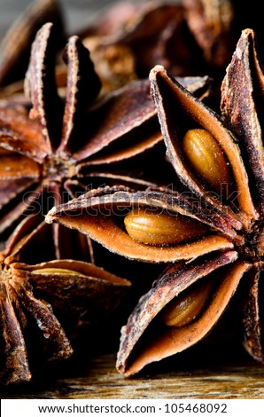 Few star anise on dark wooden table - stock photo