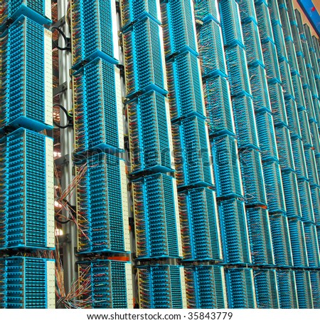 fiber cables connected to servers in a datacenter(See more network cables and servers backgrounds in my portfolio). - stock photo