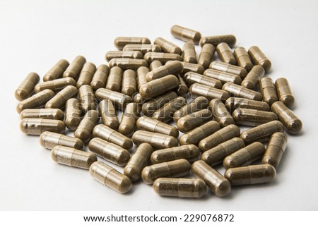 fiber capsule with white background - stock photo