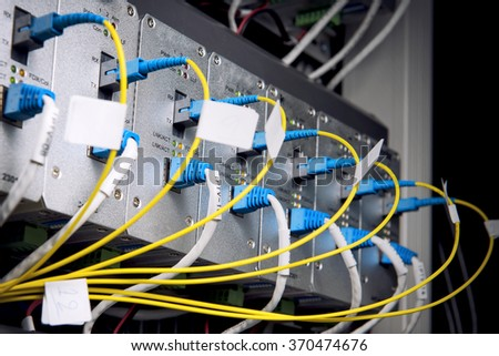 Fiber optic and UTP on core network switch - stock photo