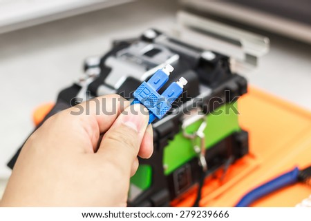 fiber optic cable splice machine - stock photo