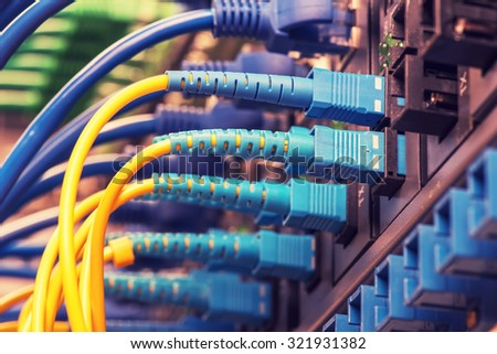 Fiber Optic cables connected  - stock photo