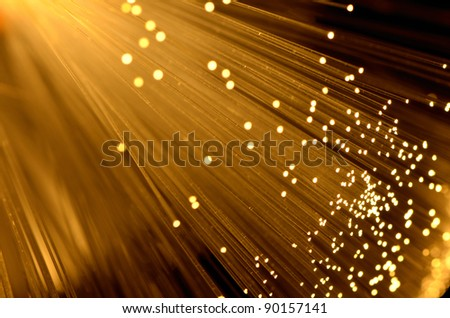 fiber optic in warm colored background - stock photo