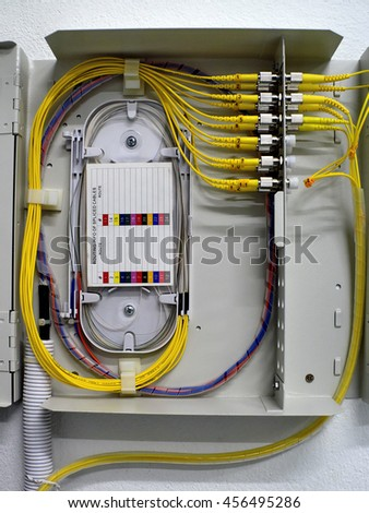 fiber optic Network Server . network cables and servers in a technology data center - stock photo