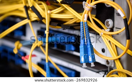 Fiber Optic on network core switch close up - stock photo