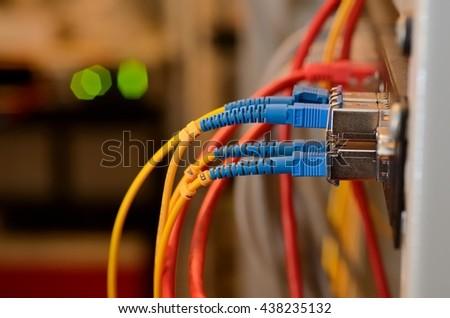 Fiber Optic on network core switch close up - stock photo