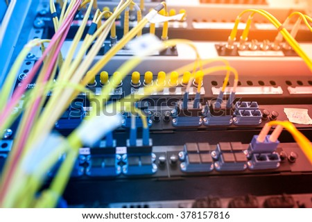 fiber optic with servers in a technology data center . - stock photo