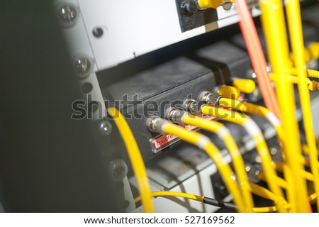 fiber optic with servers in a technology data center .