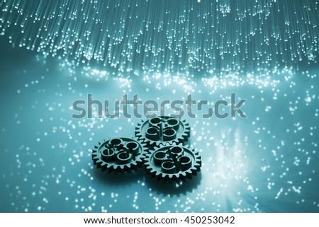 Fiber optics and gear High tech technology color background - stock photo