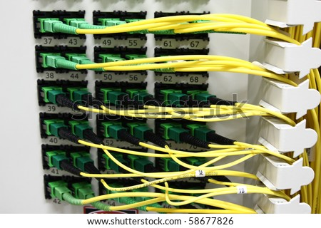 Fiber Optics with SC/APC connectors - Patch Panel. Internet Service Provider equipment. Focus on fiber optic cables. Data Network Hardware Concept. - stock photo