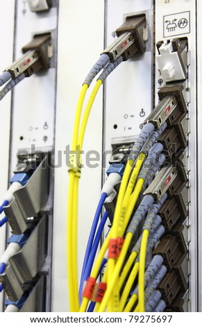 Fiber Optics with SC/MU connectors. Internet Service Provider equipment. Focus on fiber optic cables. Data Network Hardware Concept. - stock photo
