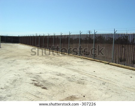 fiber rolls and a fence - stock photo
