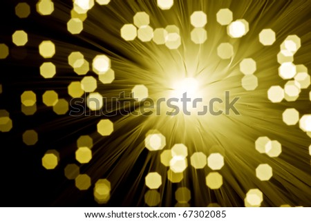 Fibre optic broadband technology concept blurred bokeh background with explosion effect - stock photo
