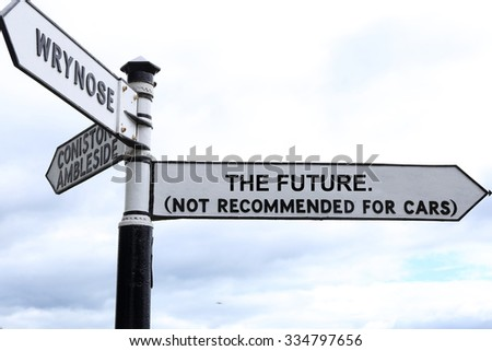 Fictitcious Road Direction Sign pointing to The Future, not recommended for cars. - stock photo