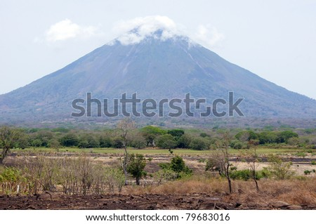 Field and cone of volcano Concepcion on the island Ometepe, Nicaragua - stock photo