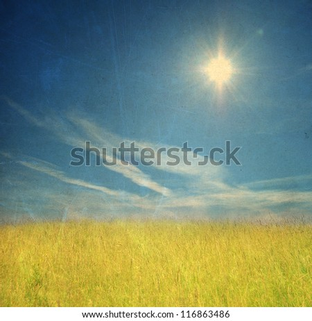 Field and sky, vintage background - stock photo