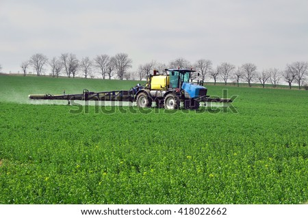 Field fertilization work fertilizer - stock photo