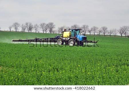 Field fertilization work fertilizer - stock photo