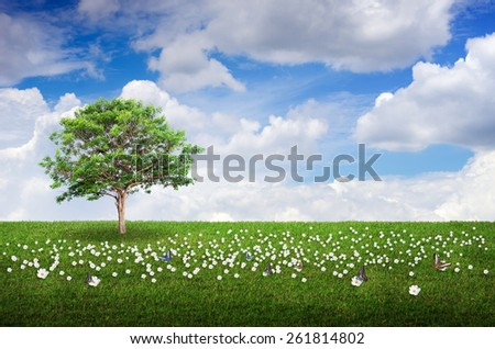 Field, flowers, trees and sky for background. - stock photo